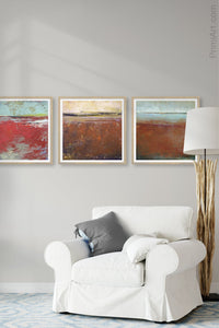 "Red abstract ocean art ""Cerise Harbor,"" metal print by Victoria Primicias, decorates the living room."