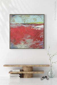 "Red abstract ocean painting ""Cerise Harbor,"" canvas print by Victoria Primicias, decorates the foyer."