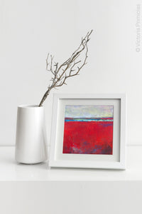 "Red abstract seascape painting ""Cherry Hollow,"" fine art print by Victoria Primicias, decorates the shelf."