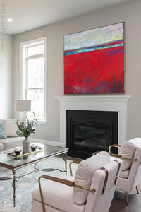 "Red abstract beach wall art ""Cherry Hollow,"" giclee print by Victoria Primicias, decorates the fireplace."