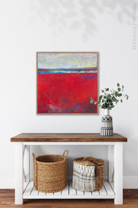 "Red abstract seascape painting ""Cherry Hollow,"" fine art print by Victoria Primicias, decorates the entryway."