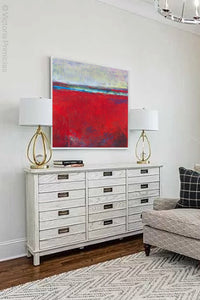 "Red abstract beach wall decor ""Cherry Hollow,"" canvas wall art by Victoria Primicias, decorates the living room."