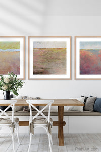 "Pink abstract beach wall art ""Cherry Inlet,"" printable wall art by Victoria Primicias, decorates the dining room."