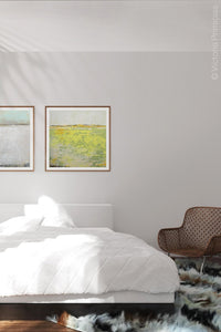 "Bright abstract landscape art ""Citrus Morning,"" downloadable art by Victoria Primicias, decorates the bedroom."