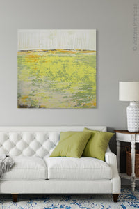 "Bright abstract landscape painting ""Citrus Morning,"" digital print by Victoria Primicias, decorates the living room."