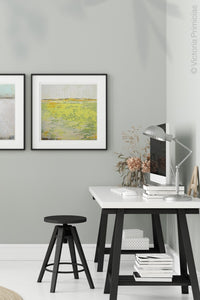 "Bright landscape painting ""Citrus Morning,"" downloadable art by Victoria Primicias, decorates the office."