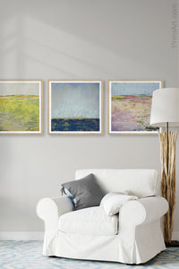 "Bright abstract landscape painting ""Citrus Morning,"" digital download by Victoria Primicias, decorates the living room."