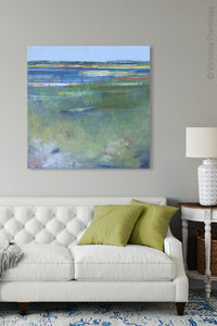 "Coastal abstract beach art ""Color Dance,"" metal print by Victoria Primicias, decorates the living room."
