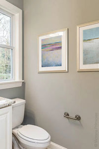 "Pink abstract seascape painting ""Common Threads,"" giclee print by Victoria Primicias, decorates the bathroom."