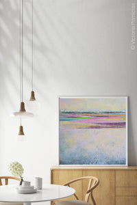 "Pink abstract beach wall decor ""Common Threads,"" canvas print by Victoria Primicias, decorates the dining room."