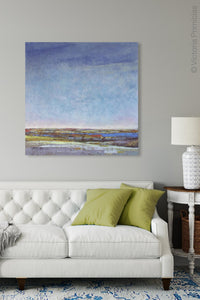 "Blue abstract seascape painting ""Confetti Chorus,"" wall art print by Victoria Primicias, decorates the living room."