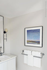 "Blue abstract beach wall decor ""Confetti Chorus,"" giclee print by Victoria Primicias, decorates the bathroom."