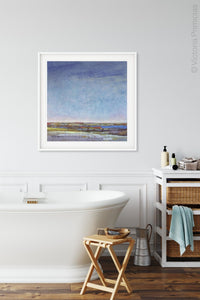 "Blue abstract seascape painting ""Confetti Chorus,"" wall art print by Victoria Primicias, decorates the bathroom."