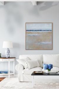 "Gray neutral abstract seascape painting ""Crib Sheets,"" canvas print by Victoria Primicias, decorates the living room."