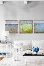"Load image into Gallery viewer, Yellow and gray abstract landscape art ""Crimson Threads,"" digital download by Victoria Primicias, decorates the living room."