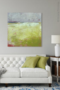"Yellow and gray abstract ocean painting ""Crimson Threads,"" digital download by Victoria Primicias, decorates the living room."