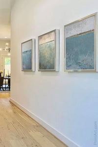 "Teal muted landscape art ""Delicate Dawn,"" downloadable art by Victoria Primicias, decorates the entryway."