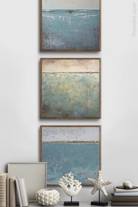 "Teal muted abstract ocean painting ""Delicate Dawn,"" digital art landscape by Victoria Primicias, decorates the foyer."