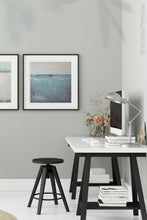 "Load image into Gallery viewer, Teal muted abstract ocean painting ""Delicate Dawn,"" digital artwork by Victoria Primicias, decorates the office."