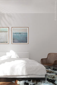 "Teal muted abstract beach painting ""Delicate Dawn,"" digital download by Victoria Primicias, decorates the bedroom."