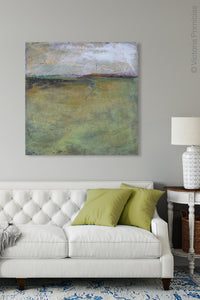 "Square abstract beach artwork ""Dijon Dunes,"" digital download by Victoria Primicias, decorates the living room."