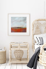"Load image into Gallery viewer, Square abstract beach art ""End of August,"" digital art landscape by Victoria Primicias, decorates the bedroom."