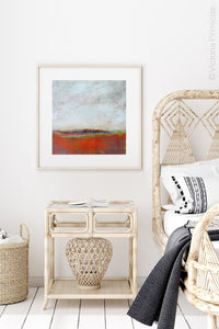 "Square abstract beach art ""End of August,"" digital art landscape by Victoria Primicias, decorates the bedroom."