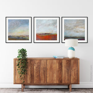 "Square abstract beach wall art ""End of August,"" digital art landscape by Victoria Primicias, decorates the entryway."