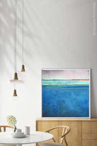"Serene blue abstract beach wall decor ""Evening Veil,"" canvas wall art by Victoria Primicias, decorates the dining room."