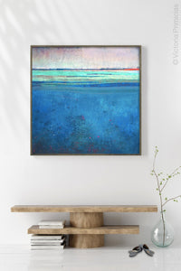 "Serene blue abstract beach wall art ""Evening Veil,"" giclee print by Victoria Primicias, decorates the hallway."