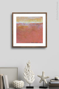 "Red orange abstract beach art ""Fading Beauty,"" digital art landscape by Victoria Primicias, decorates the wall."