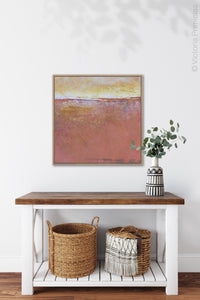"Red orange abstract beach wall art ""Fading Beauty,"" digital artwork by Victoria Primicias, decorates the entryway."