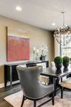 "Load image into Gallery viewer, Red orange abstract seascape painting""Fading Beauty,"" digital print by Victoria Primicias, decorates the dining room."