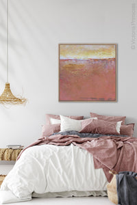 "Red orange abstract beach art ""Fading Beauty,"" digital artwork by Victoria Primicias, decorates the bedroom."