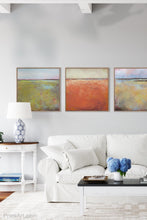 "Load image into Gallery viewer, Square abstract beach wall decor ""Fading Light,"" printable wall art by Victoria Primicias, decorates the living room."