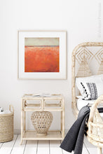 "Load image into Gallery viewer, Square abstract beach wall decor ""Fading Light,"" printable wall art by Victoria Primicias, decorates the bedroom."