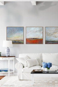 "Square abstract landscape art ""Faraway Nearby,"" digital artwork by Victoria Primicias, decorates the living room."