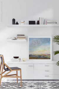 "Square abstract landscape art ""Faraway Nearby,"" printable art by Victoria Primicias, decorates the office."