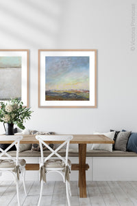 "Square landscape painting ""Faraway Nearby,"" downloadable art by Victoria Primicias, decorates the dining room."