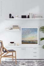 "Load image into Gallery viewer, Square abstract beach painting ""Faraway Nearby,"" fine art print by Victoria Primicias, decorates the office."