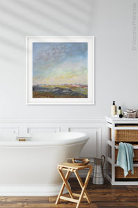 "Square abstract landscape painting ""Faraway Nearby,"" wall art print by Victoria Primicias, decorates the bathroom."