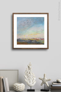 "Square abstract landscape painting ""Faraway Nearby,"" wall art print by Victoria Primicias, decorates the wall."