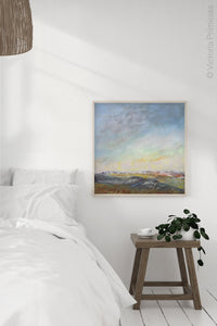 "Square abstract beach painting ""Faraway Nearby,"" fine art print by Victoria Primicias, decorates the bedroom."