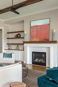 "Minimalist abstract beach painting ""Feral Tidings,"" digital print by Victoria Primicias, decorates the fireplace."