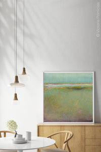 "Coastal abstract landscape painting ""Fine Margin,"" digital print by Victoria Primicias, decorates the dining room."