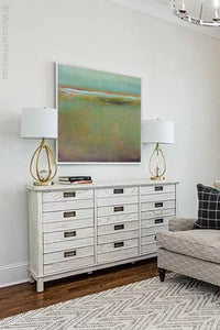 "Coastal abstract landscape painting ""Fine Margin,"" digital download by Victoria Primicias, decorates the living room."