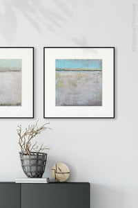 "Neutral color abstract coastal wall art ""Finnish Line,"" wall art print by Victoria Primicias, decorates the entryway."