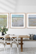 "Load image into Gallery viewer, Neutral color abstract coastal wall decor ""Finnish Line,"" fine art print by Victoria Primicias, decorates the dining room."