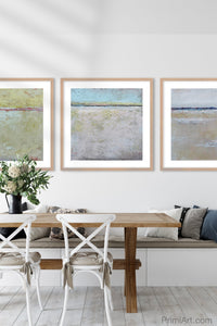 "Neutral color abstract coastal wall decor ""Finnish Line,"" fine art print by Victoria Primicias, decorates the dining room."