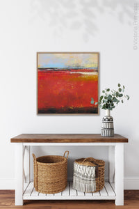 "Large red abstract beach wall decor ""Fire Sea,"" wall art print by Victoria Primicias, decorates the entryway."